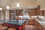 Beautiful kitchen with stainless steel appliances and a large island
