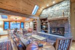 211 Adams Ranch Retreat with impressive stone fireplace and built-ins