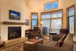 Wonderful living area with tons of natural light, a gas fireplace, and access to the deck