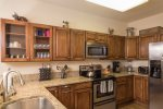 Fully-equipped kitchen with granite countertops and stainless steel appliances