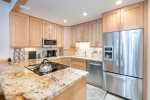 Beautiful, open concept kitchen with stainless steel appliances