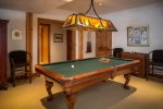 Ground floor media room includes pool table. Fun for everyone