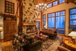 Massive Great Room with wood burning fireplace and large picture windows