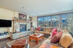 Enjoy the warmth of a fire and big mountain views from this beautiful, open concept living area