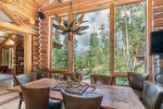 Big picture windows and tall ceilings bring the outside in