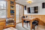An intimate dining nook with views out onto the ski area