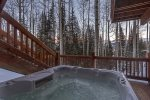 Watch the sunset over the mountains from the large, private hot tub