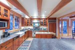 Find all the amenities in the kitchen plus stools under the island