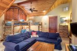 Upstairs lofted bunk room with sectional sleeper sofa, flat screen TV
