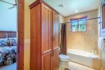 Full en suite second master bathroom with shower/tub combo