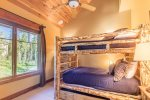 Bunk room with full size beds plus a trundle bed, full bathroom