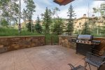 Enjoy this large patio with gas BBQ grill, outdoor seating, the hot tub, and a fire pit