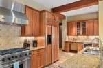 The beautiful, gourmet kitchen has stainless steel appliances and granite countertops