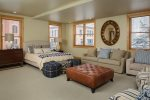 Second master suite located on middle level, queen bed, sitting area with sofa and club chairs