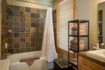 Second master en suite bathroom with large shower/tub combo