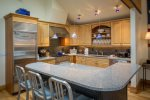 Gorgeous kitchen with high-end appliances, breakfast bar with seating for 3