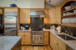 Fully equipped gourmet kitchen with stainless appliances, granite counter tops