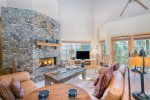 The beautiful open concept living space has a gas fireplace and flatscreen TV