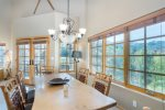 Enjoy the formal dining table with seating for 6-8 and amazing views to the ski area