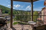 Private deck with ski area views, outdoor furniture, and a BBQ grill
