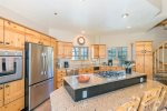 Fully-equipped kitchen with stainless steel appliances and plenty of counter space