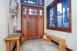 Beautiful entryway with a bench to remove your snowy shoes