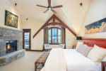 Private level master suite with King bed, gas fireplace