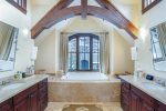 Massive master bathroom with soaking tub and double vanities