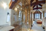 Master bathroom with travertine tile work, soaking tub, steam shower