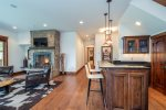 The downstairs den includes a fireplace and wet bar