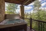 Hot tub located on ground floor patio, accessible through the den and ski locker area