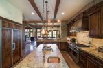 Impeccable gourmet kitchen with granite countertops and stainless steel appliances