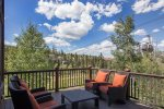 Outdoor deck located off living area with all-weather furniture and gas BBQ grill