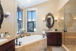 En suite 3rd guest bathroom with a large soaking tub and walk-in shower