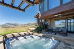 Large, in-ground hot tub with beautiful mountain views