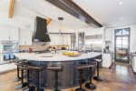 Step into the impressive kitchen with a massive island and 8 breakfast bar stools