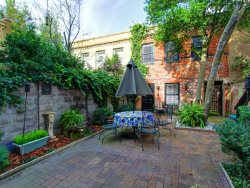 Walk everywhere from this classy and cute carriage house with a beautiful courtyard.