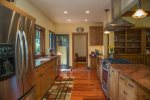 Gourmet Galley Kitchen with Granite Counters, Stainless Steel Appliances