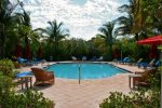 Ample Poolside Seating and Tropical Landscaping Surround the Heated Pool  Florida Keys Vacation Rental