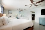 The Sunny Master Bedroom Features an En Suite Master Bathroom  Florida Keys Vacation Rental