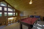 Open Loft with a Pool Table and a Day Bed
