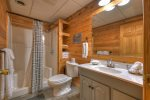Lower Level Bathroom with a Shower Stall