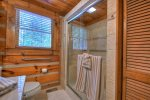 Main Floor Bathroom with a Large Walk-In Tile Shower