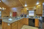 Kitchen with Electric Appliances and Granite Counter Tops