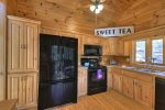 Kitchen with Black electric Appliances
