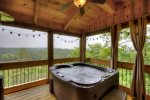 Hot Tub with a great view located on the main floor screened in porch