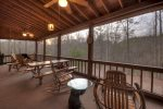 Main Floor Screen Proch with Rocking Chairs, Swing and a Picnic Table