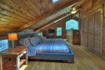 Open Loft Master Bedroom with a King Bed, flat Screen TV and a Private Open Porch