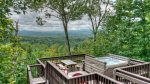 Large Open Deck with a 4- Person Hot Tub looking at the View