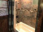 Loft Master Bathroom with a Tub Shower Combo